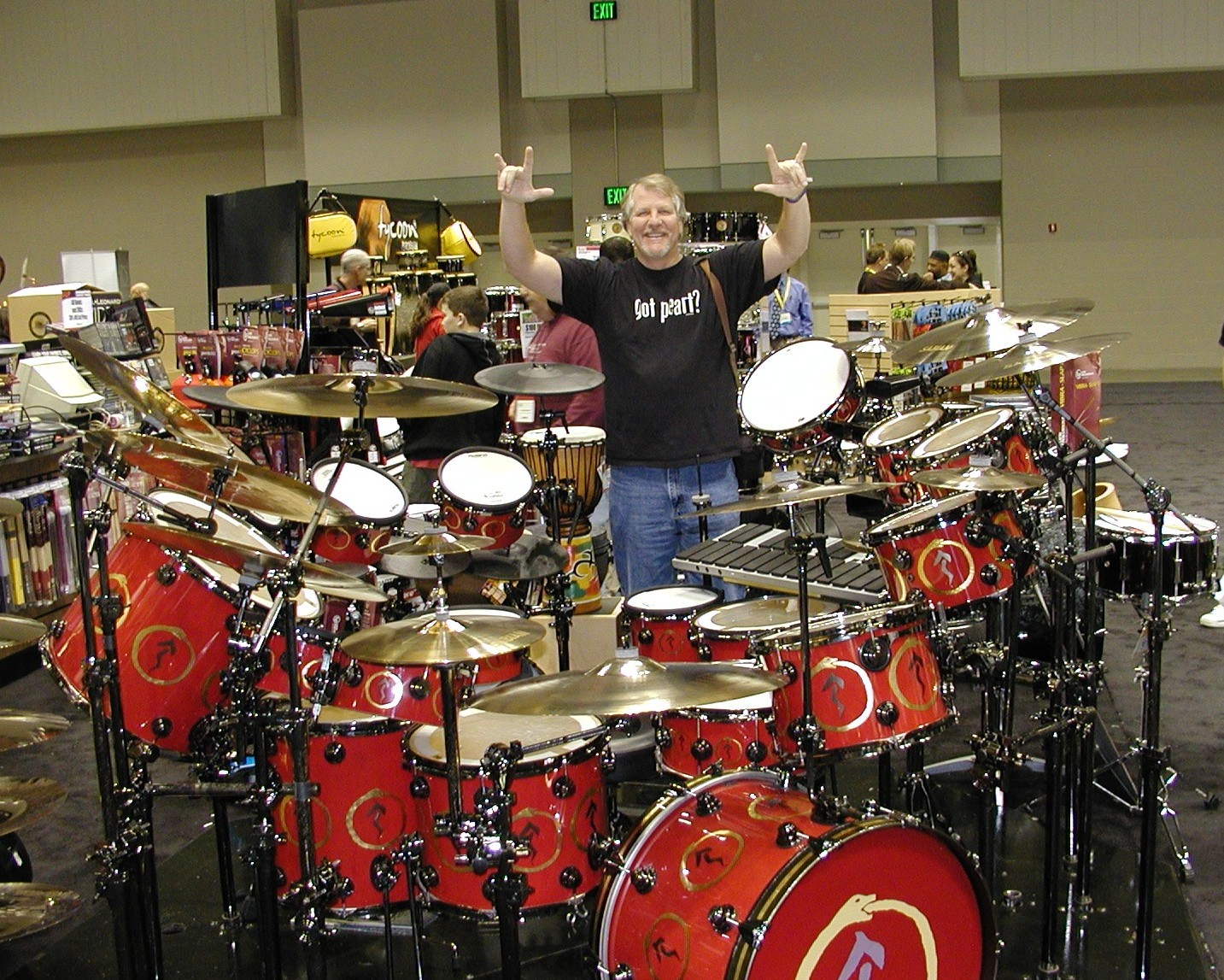 Doug Foley stands behind Peart's Snakes kit.