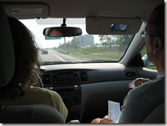 Monica and Ray in the front seat